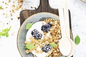 Granola with yogurt and blackberries