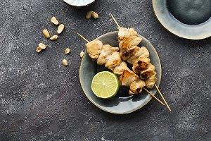 Teriyaki chicken skewers, cabbage