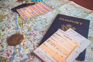 Passport sits on Map of Paris