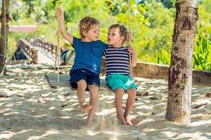 Two little blonde boys having fun on