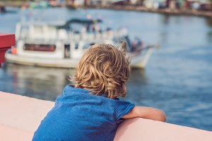 The boy admires the sea and