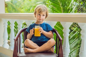 Boy drinking juicy smoothie from