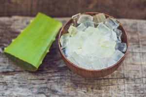 Aloe vera and aloe cubes in a wooden