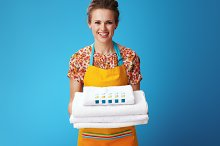 smiling young housewife with white l