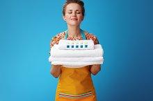 happy young housewife enjoying fresh