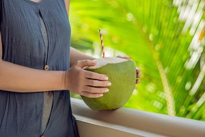 coconut in beautiful female hands on