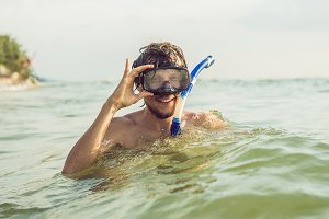 A man with a mask and snorkel is