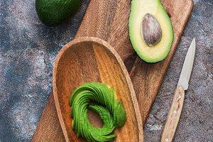 Fresh avocado sliced in a wooden
