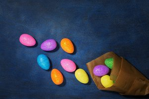 Easter colored eggs in paper bag on
