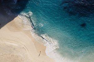 sandy beach blue water surf