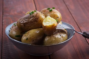 Baked baby potato with green onion o