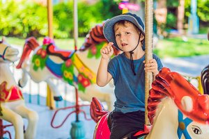 Cute little boy enjoying in funfair