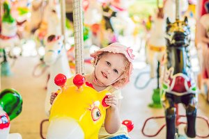 Cute little girl enjoying in funfair