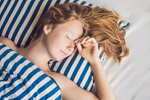 Young beautiful woman sleeping in