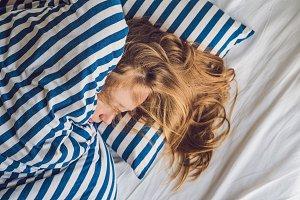 Beautiful young woman lying down in