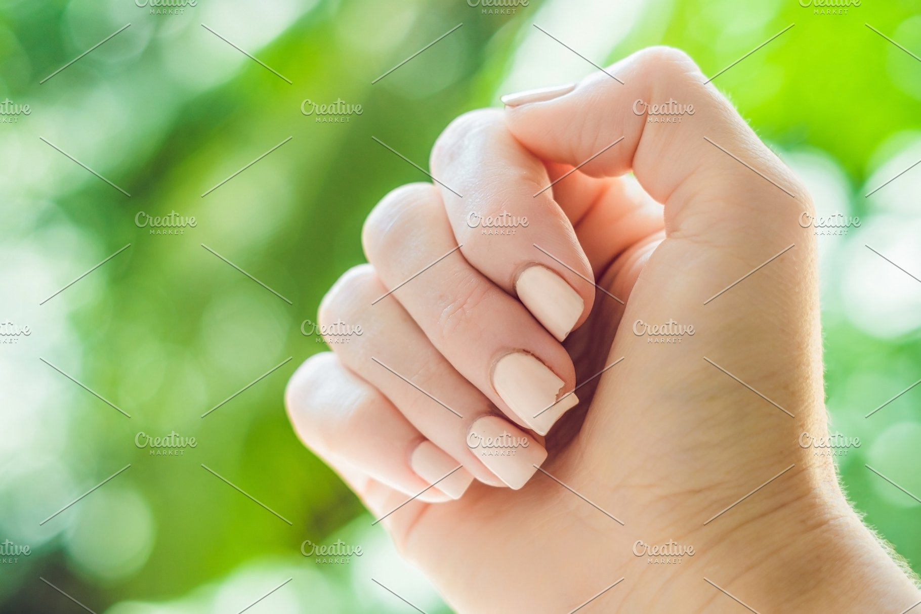 Broken nail on a woman\'s hand with a ~ People Photos ~ Creative Market