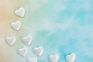 White decorative hearts on blue