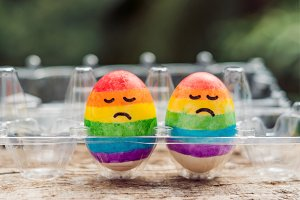 Two eggs are colored in the colors