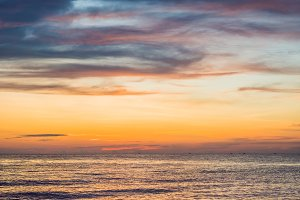 Sunset sky over sea panorama