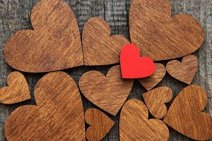 Red wooden heart on a wooden heart b