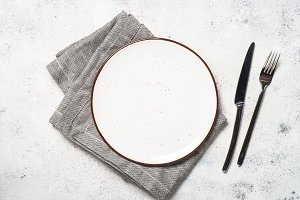 White craft plate, cutlery and