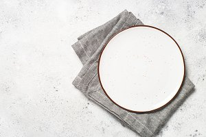 White craft plate and napkin on