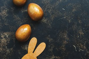 Golden Easter eggs and rabbit on a