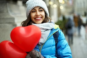 happy young woman in warm winter