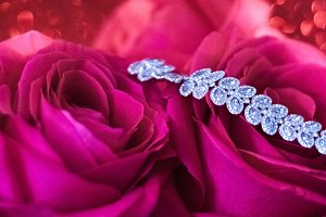 diamond bracelet and red roses