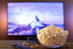 A glass bowl of popcorn, 3d glasses