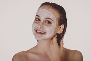 Smiling woman with face mask