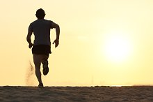 Back view silhouette of a runner man running on the beach.jpg