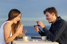 Boyfriend requesting for hand of his girlfriend with a engagement ring.jpg