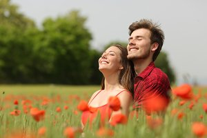 Couple hugging and breathing fresh air in a red field.jpg