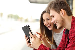 Couple sharing media content from a tablet.jpg