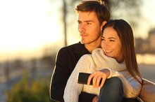 Couple relaxing and hugging looking at sunset.jpg