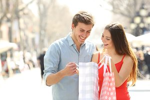 Couple shopping and holding bags in the street.jpg
