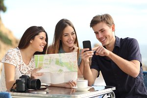 Group of young tourist friends consulting gps map in a smart phone.jpg