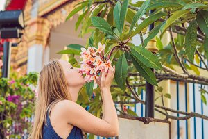 Young woman tourist in Thai temple