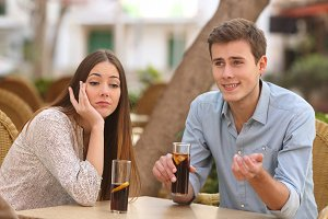 Man and woman dating but she is boring while he speaks.jpg