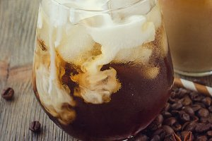 Cold refreshing iced coffee in glass