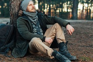 Pensive hipster guy wanderlust with