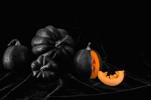 four black pumpkin and cut pumpkin o