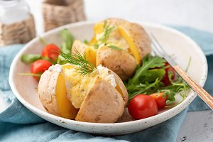 Stuffed potatoes baked with cheese