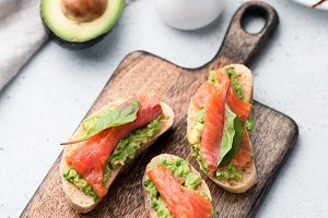 Sandwiches with avocado and salmon