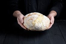loaf of baked round bread by  in Food & Drink