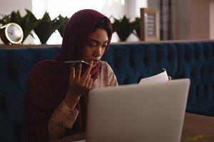 Businesswoman in hijab talking