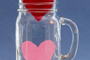 Two paper hearts inside  jar