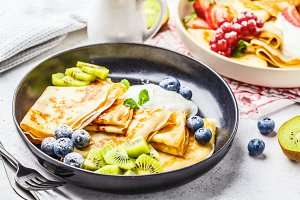 Homemade thin crepes with fruits
