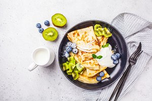 Thin crepes with cream and fruits